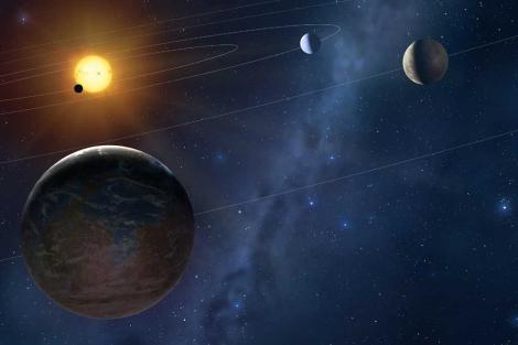 Recreación de cuatro exoplanetas en torno a una estrella.|Mark A. Garlick
