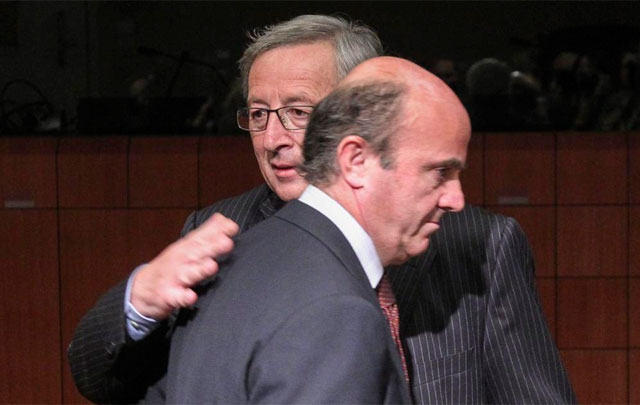 Juncker y Guindos, anoche en el Eurogrupo. | Efe