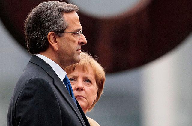 Merkel y su homólogo griego Samaras, el viernes en la visita de éste a Berlín. | Reuters