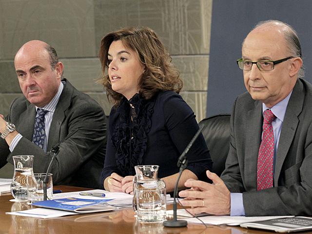 Guindos, Sáenz de Santamaría y Montoro, en la presentación de los Presupuestos. | Barrenechea / Efe