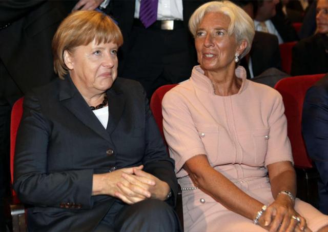 La directora gerente del FMI (d), en un acto con la canciller alemana. | Reuters
