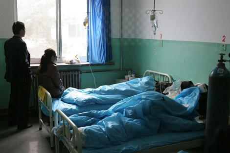 Pacientes en un hospital al norte de China.| Afp